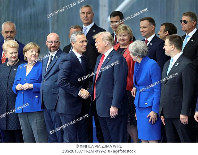 July 11, 2018 - Brussels, Belgium - NATO Secretary General JENS STOLTENBERG (center L) shakes hands with U.S. President DONALD TRUMP during a NATO summit in...