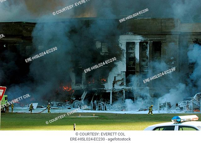 Firefighters work to put out the flames moments after a hijacked jetliner crashed into the Pentagon at approximately 9 30 AM on Sept. 11 2001
