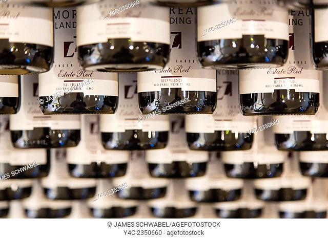 Wine bottles in rack in a winery in the Finger Lakes Region of New York State