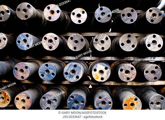 Axles for railroad train wheels stored at machine shop awaiting assembly, Tacoma, Washington USA