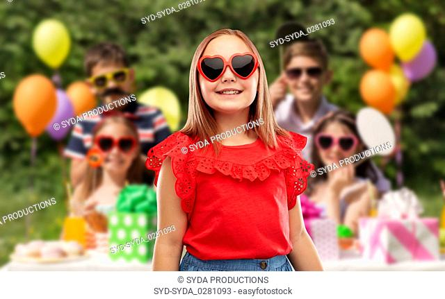 girl in heart shaped sunglasses at birthday party