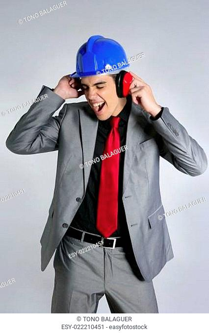 Businessman with blue hardhat and safety headphones