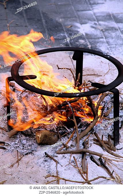 camp fire for paella pans Denia Spain