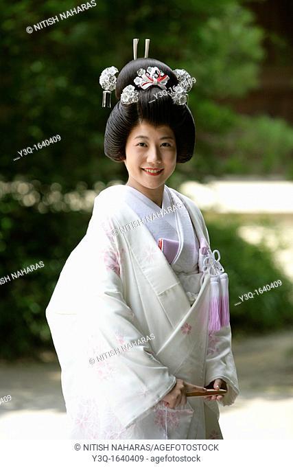 Japanese bride in wedding dress at Meiji Jingu Shrine in Tokyo, Japan