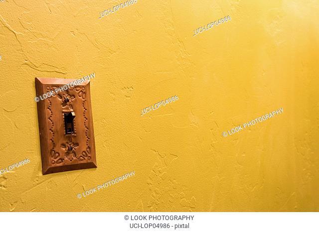 Brasss Lightswitch on Yellow Wall