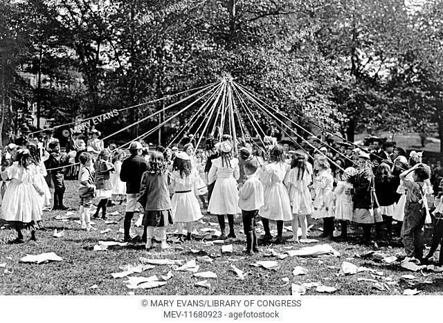 Children dancing around a Maypole in Central Park in New York, USA