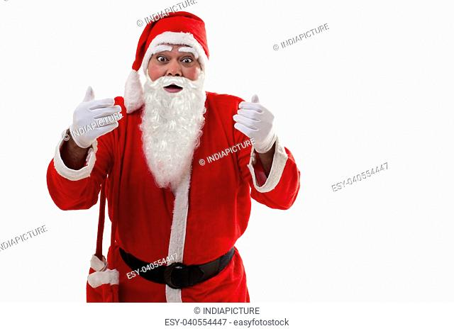 Front view of surprised Santa Claus standing over white background