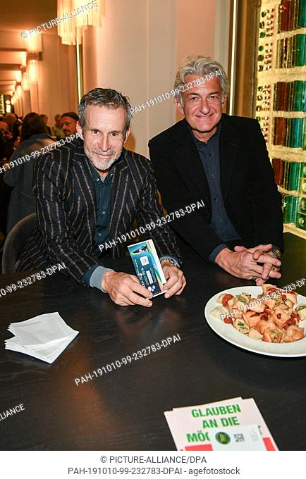 """09 October 2019, Berlin: Ulrich Matthes (l) and Dominic Raacke at the premiere of """"""""Faith in the Possibility of the Complete Renewal of the World"""""""" in the..."""