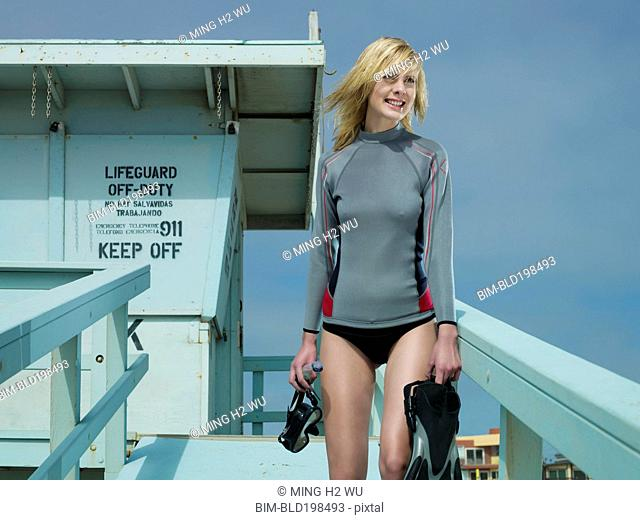Caucasian lifeguard standing at lifeguard station