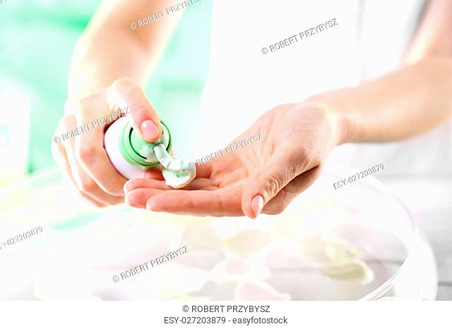 manicured hands in the summer. women's hands during surgery cosmetic hands with applied mask with green clay
