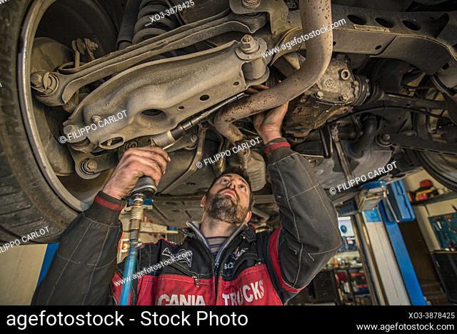 MILAN, ITALY: Mechanic repairs the car
