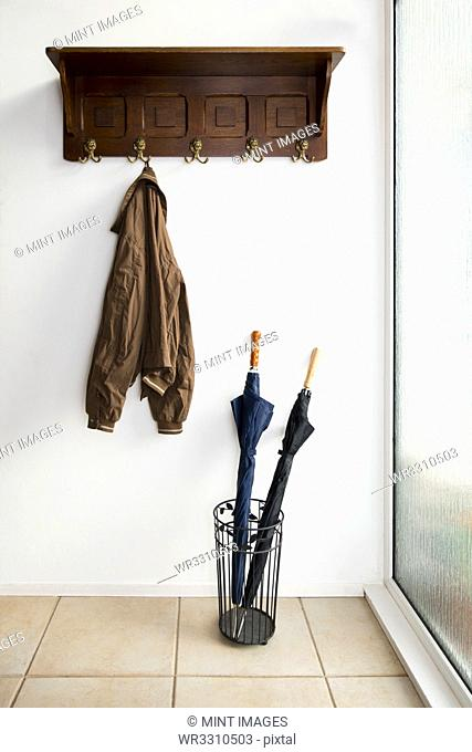 Jacket and umbrellas in foyer of home