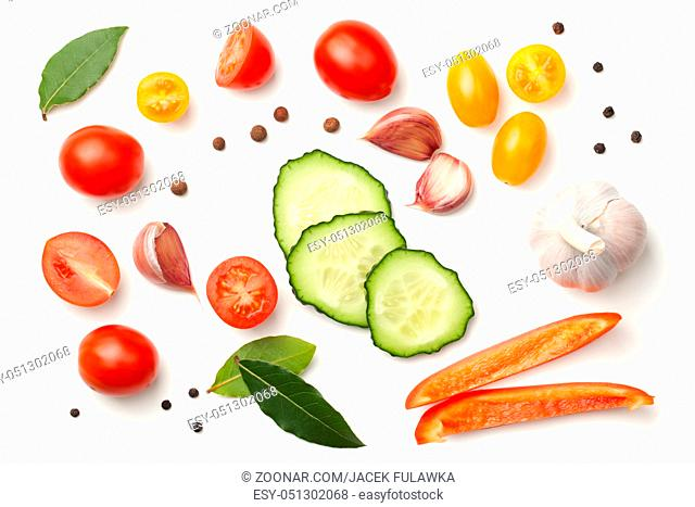 Tomatoes, garlic, bay leaves, pepper and peppercorn isolated on white background. Top view