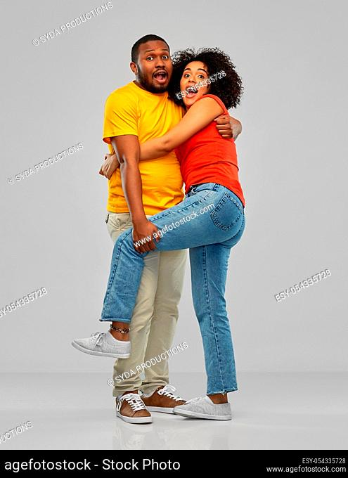 scared african american couple hugging