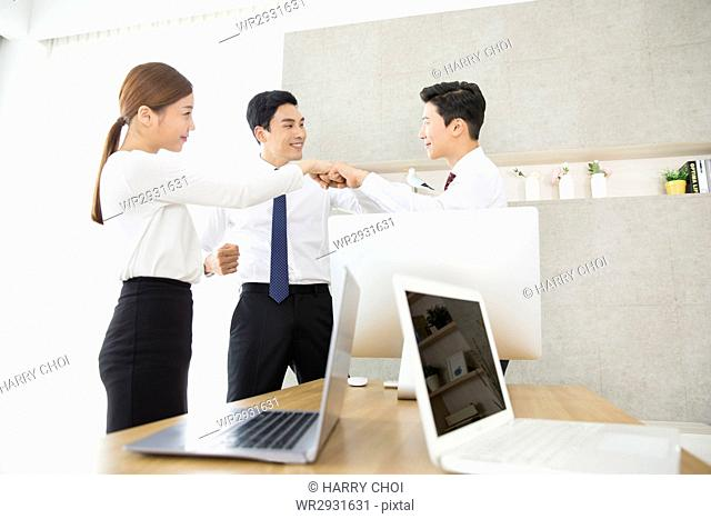 Smiling business folding hands