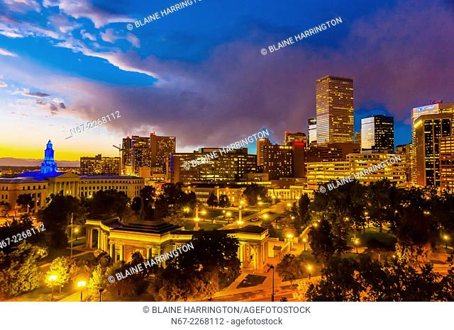 Skyline with City & County Building on left and Civic Center Park in foreground, Downtown Denver, Colorado USA