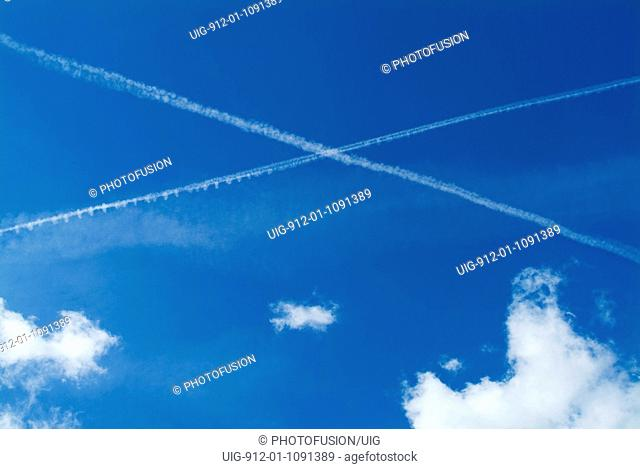 Airplane vapour trails in shape of a cross in the sky