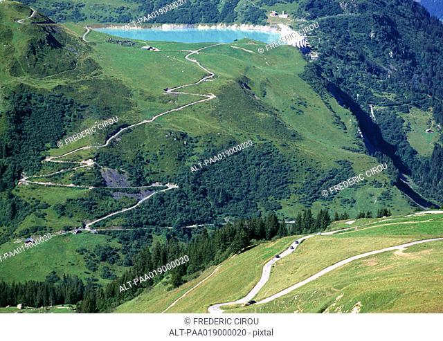 France, Savoie, roads through mountains, one leading to blue lake