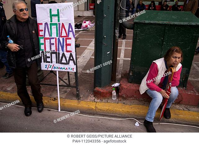 """Greek pensioners during protest against planned cut in pension payments beginning 2019. Sign """"""""Hope has become a razorblade"""""""". 20.11"""
