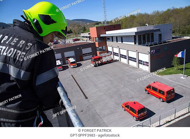 FIREFIGHTERS ON THE BIG LADDER AT THE EMERGENCY SERVICES DEPARTMENT OF AUTUN, FIRE STATION CONFORMING TO HIGH QUALITY ENVIRONMENTAL STANDARDS