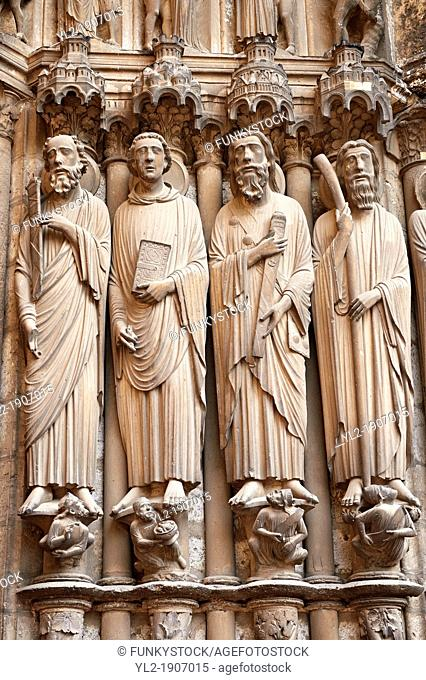 South Porch right jam  Cathedral of Chartres, France  Gothic statue of the Apostles haloed, carrying the instruments of their deaths  From left to right they...