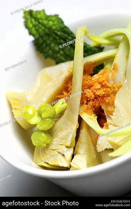 Brandade of cod with artichokes in a small white bowl