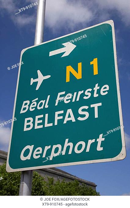green sign in dublin city centre for belfast and the N1 road and airport in irish aerphort dublin republic of ireland