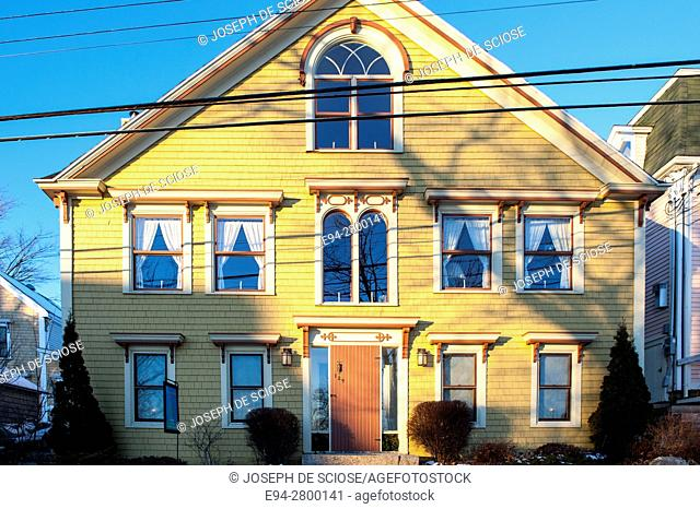 Example of home architecture showing many windows on the front of a house in Lunenburg, Nova Scotia, Canada