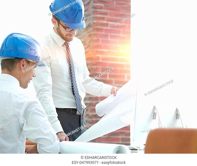 architect and construction foreman to discuss a new project under construction building