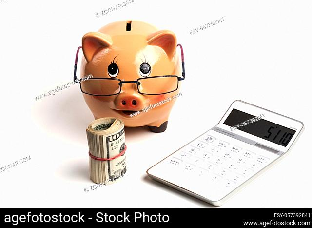 Piggy Bank With Dollars Roll and Calculator Isolated on White Background