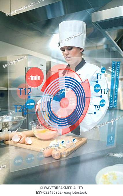 Pastry chef making dough while consulting futuristic interface that shows time