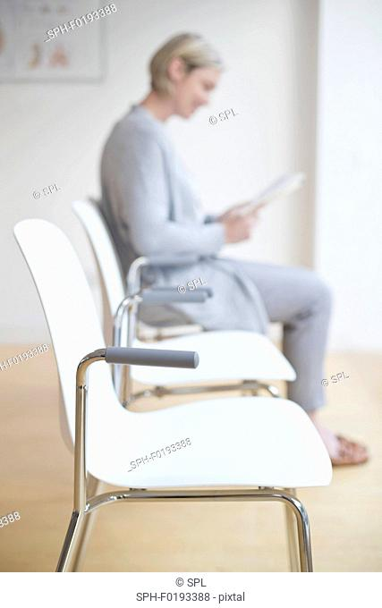 Woman sitting in doctor's waiting room