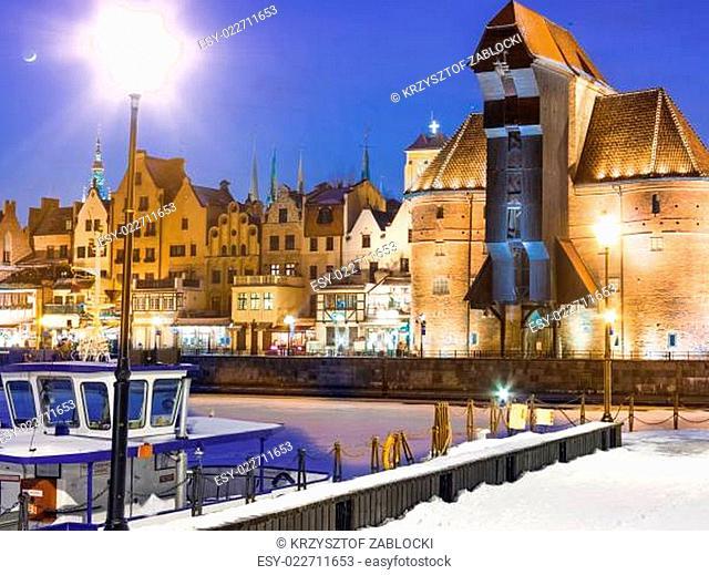 Moltawa river and the crane Gdansk Poland. Winter night scenery