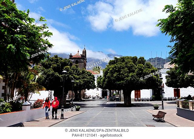 A pictutre dated 19 May 2016 shows the pedestrian area with the church of Nestra Senora de Los Remedios in Los Llanos de Aridane on the Canary island of La...