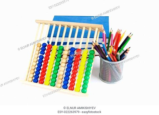 Education concept with pencils, books and abacus