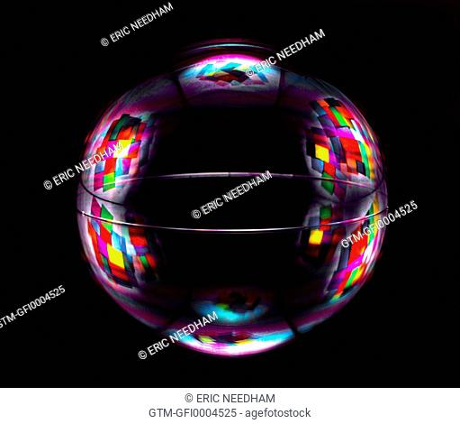 Bubble on a Mirror with coloured design black background