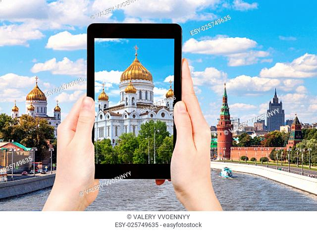 travel concept - tourist photographs picture of Cathedral of Christ the Saviour, Moscow on tablet pc