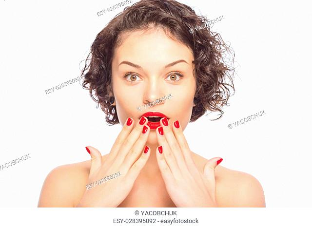 Feeling amazed. Young appealing lady upholds hands at her mouth looking startled