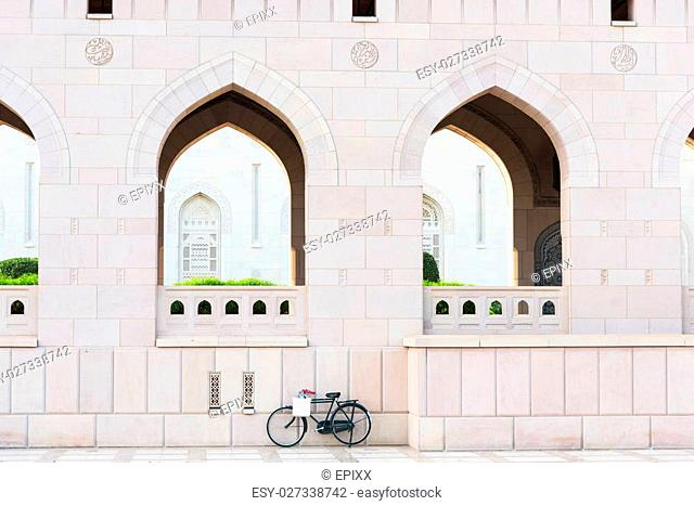 Bicycle parked outside Sultan Qaboos Grand Mosque in Muscat, the main mosque of The Sultanate of Oman