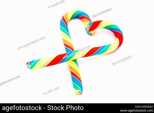 Candy cane heart over white