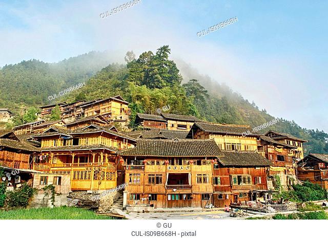 Misty mountain and Xijiang village, Guizhou, China