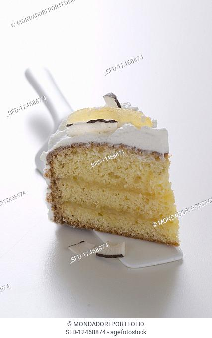 A slice of lemon cake with marshmallow frosting