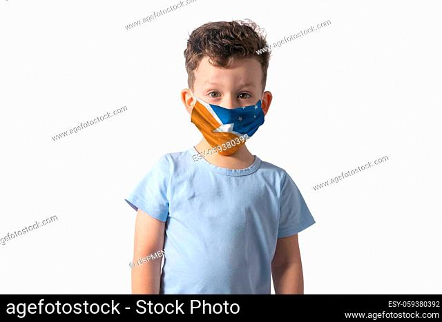 Respirator with flag of Argentine Antarctica. White boy puts on medical face mask isolated on white background