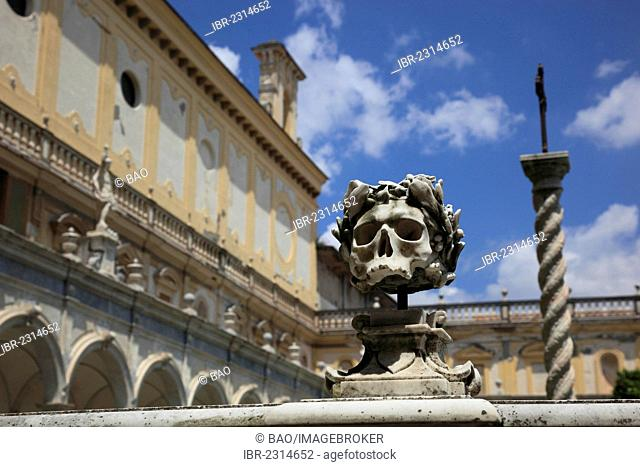 Skull on the balustrade of the monastic cemetery, big cloister of the Certosa di San Martino monastery, Vomero district above Naples, Campania, Italy, Europe