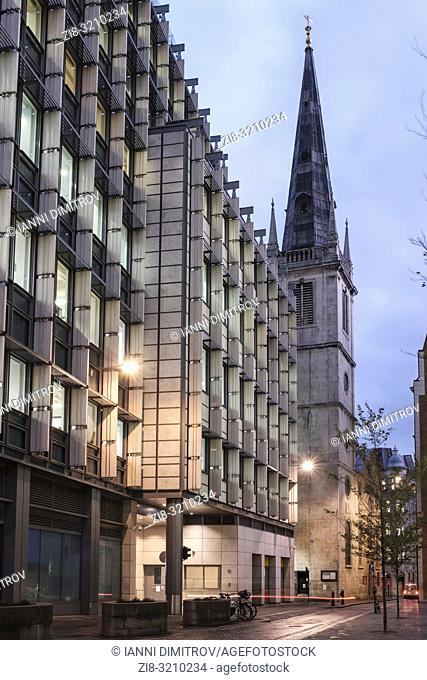 England, City of London,Rood Lane- contemporary office buildings and Saint Margaret Pattens Church of england at night. The church's exterior is notable for its...