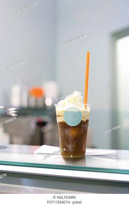 Close-up of iced coffee on counter at store