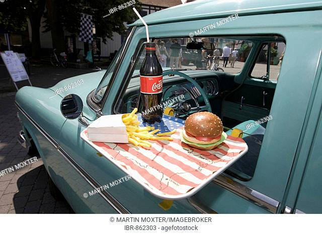 Plymouth Savoy Four 1955, with a tray hanging on the window with a hamburger, a bottle of cola and french fries, Dreieich, Hesse, Germany, Europe