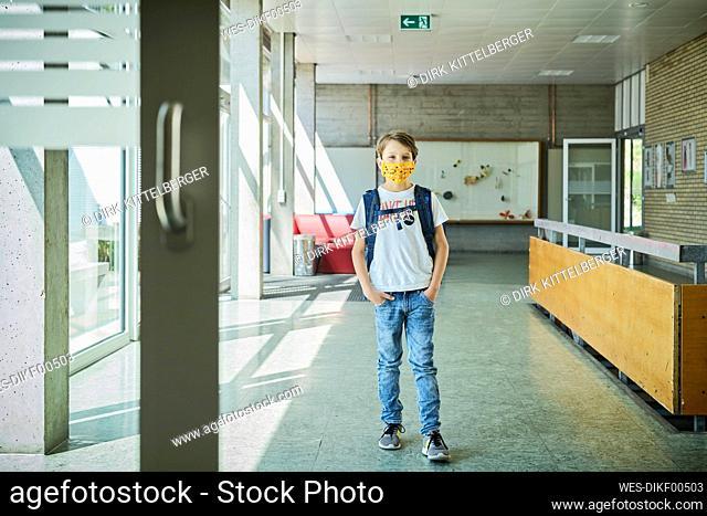 Boy wearing mask in school