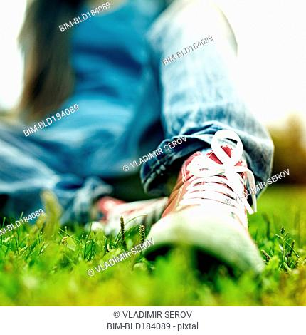 Close up of Caucasian woman wearing sneakers