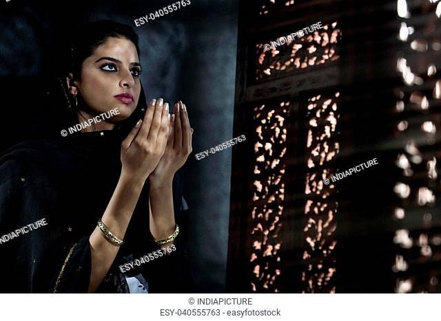 Muslim woman doing Namaaz